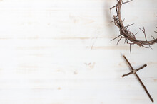 Crown Of Thorns And Cross On White Wood Background With Copy Space