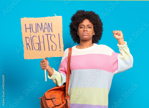 Fotografia, Obraz young pretty afro woman protesting with human rights banner