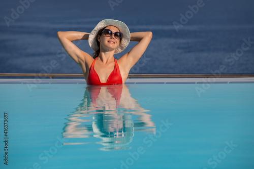 Fototapeta ptretty woman on resort obraz
