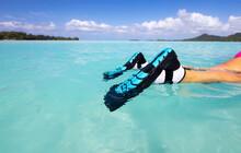 Blue Snorkel Fins On Snorkeler Over Tropical Ocean Water