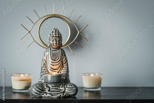 Fotografia Candlestick in the shape of a buddha