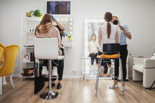 Makeup Artists Make Up Young Women In Beauty Salon. Customer Service In Interior Room To Create An Amazing Image. Work Make Up Creation Wizard. Concept Of Style And Measure Satisfaction. Copy Space