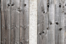 Timber Fence With Vertical Timber Planks  & Textured Surface With Central Concrete Support