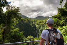 Tourist Looking At The La Fortuna Waterfall In Costa Rica