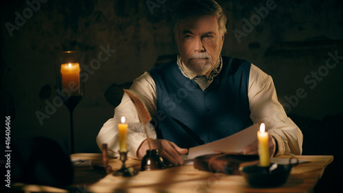 Fotografering An 18th century man ponders a document he has been reading.