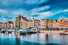 """AMSTERDAM, NETHERLANDS - SEPTEMBER 15, 2015: Beautiful Views Of The Streets, Ancient Buildings, People, Embankments Of Amsterdam - Also Call """"Venice In The North"""". Netherlands"""
