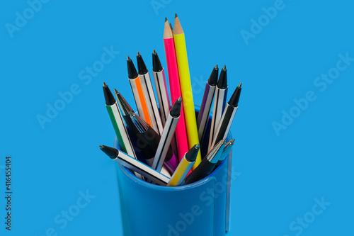 Fotografia, Obraz pens and pencils lying in a blue penholder