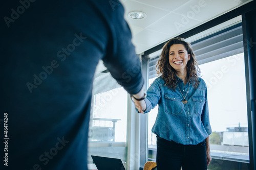 Businesswoman shaking hands with a job applicant