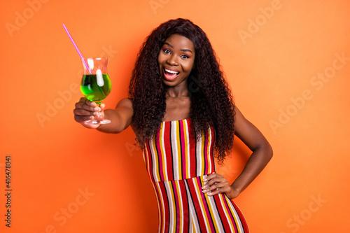 Fényképezés Photo of dark skin cheerful woman hold hand waist cocktail drink cheers isolated