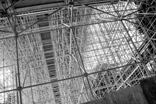 Huge Metal Scaffolding In Construction Site, Texture Background Of Steel Structure