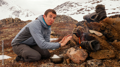 Fotografia, Obraz Male Hikers Snow trekking and wild camping on the Arctic Circle Trail in Greenland between Kangerlussuaq and Sisimiut during winter season
