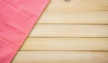 Wood Table With Classic Pink Plaid Fabric Or Tablecloth In The Corner