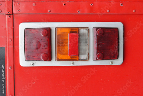 Платно Close Up of Tail Lights on Old Red Motor Bus