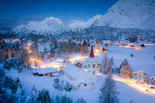 Dusk Over Chiesa Bianca And Maloja Village Covered With Snow, Bregaglia, Engadine, Graubunden Canton, Switzerland, Europe