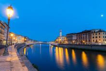 Old Lanterns And Buildings At Dusk With Ponte Di Mezzo Bridge On Banks Of Arno River, Lungarno, Pisa, Tuscany, Italy, Europe