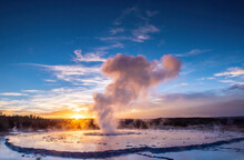 Great Fountain Geyser At Sunset With Reflection And Sunburst, Yellowstone National Park, UNESCO World Heritage Site, Wyoming, United States Of America, North America