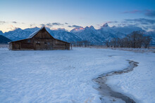 First Light On Teton Range At Moulton Barn In The Snow, Grand Teton National Park, Wyoming, United States Of America, North America