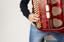 Young Man Playing Accordion On The White Background