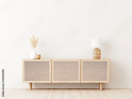Obraz na plátne Living room interior wall mockup in minimalist Japandi style with caned console, wicker basket lamp and dried pampas grass in ceramic vase on empty warm white background