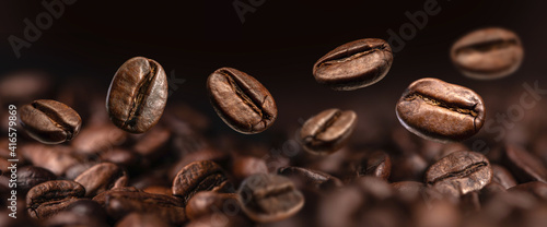 Coffee Beans Closeup On Dark Background Fotobehang