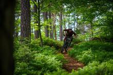 A Mountain Biker Does MBT Trail Biking In The Forests Of Klagenfurt In The Kärnten Region Of Austria.