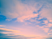 Wide Blue Pinkish Sunset Sky,colorful Clouds Stretching Away On Beautiful Sunny Evening.Horizontal Banner,air Texture Abstract Backdrop For Text,blog,design,agency,website,pattern,model.Copy Space