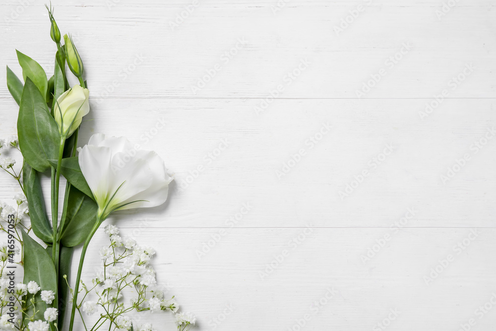 Fototapeta Beautiful flowers on white wooden background, flat lay. Space for text