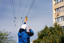 Electromagnetic Radiation Measuring Under High Voltage Power Transmission Towers Among Buildings