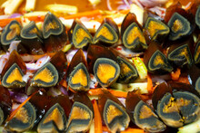 Street Food Market In Asia. A Close-up, Traditional Dish Of Sliced Pickled Chicken Eggs