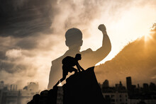 Never Give Up, Mental Strength And Determination. Strong Determined Businessman In The City With Fist In The Air.