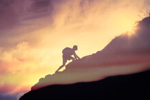 Fit And Mentally Strong Man Climbing Up Mountain. Strength, And Motivation Concept.