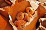 Fresh bagels in a paper bag