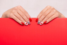 Beautiful Female Hands With Stylish Manicure Nails, Red Gel Polish, Heart And Valentine's Day Design, With Place For Text