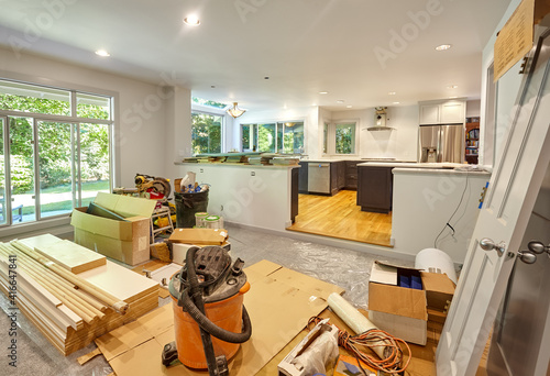 Fotografie, Obraz Family room storing tools and supplies - Shelves, circular saw, doors and other