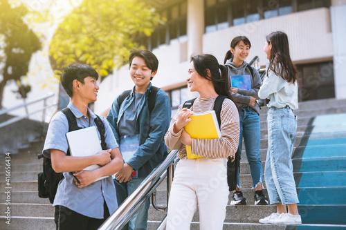 Fototapeta Happy Teenager Students talking and Walking On Stairs obraz