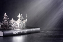 Holy Bible And A Kings Crown On A Dark Moody Background