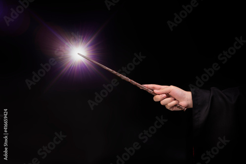 Fotografija Magic wand with sparkle, Miracle magical wand stick with light sparkle