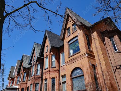 Fototapeta premium Old tall narrow Victorian row houses with gables
