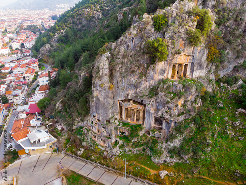 Scenic view of antique Greek rock burial chambers in Turkish village of Fethiye Fototapeta