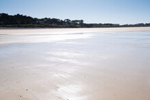 """Large Sandy Beach In The Town Of """"Sables D'or Les Pins"""" In Brittany At Low Tide In Summer"""
