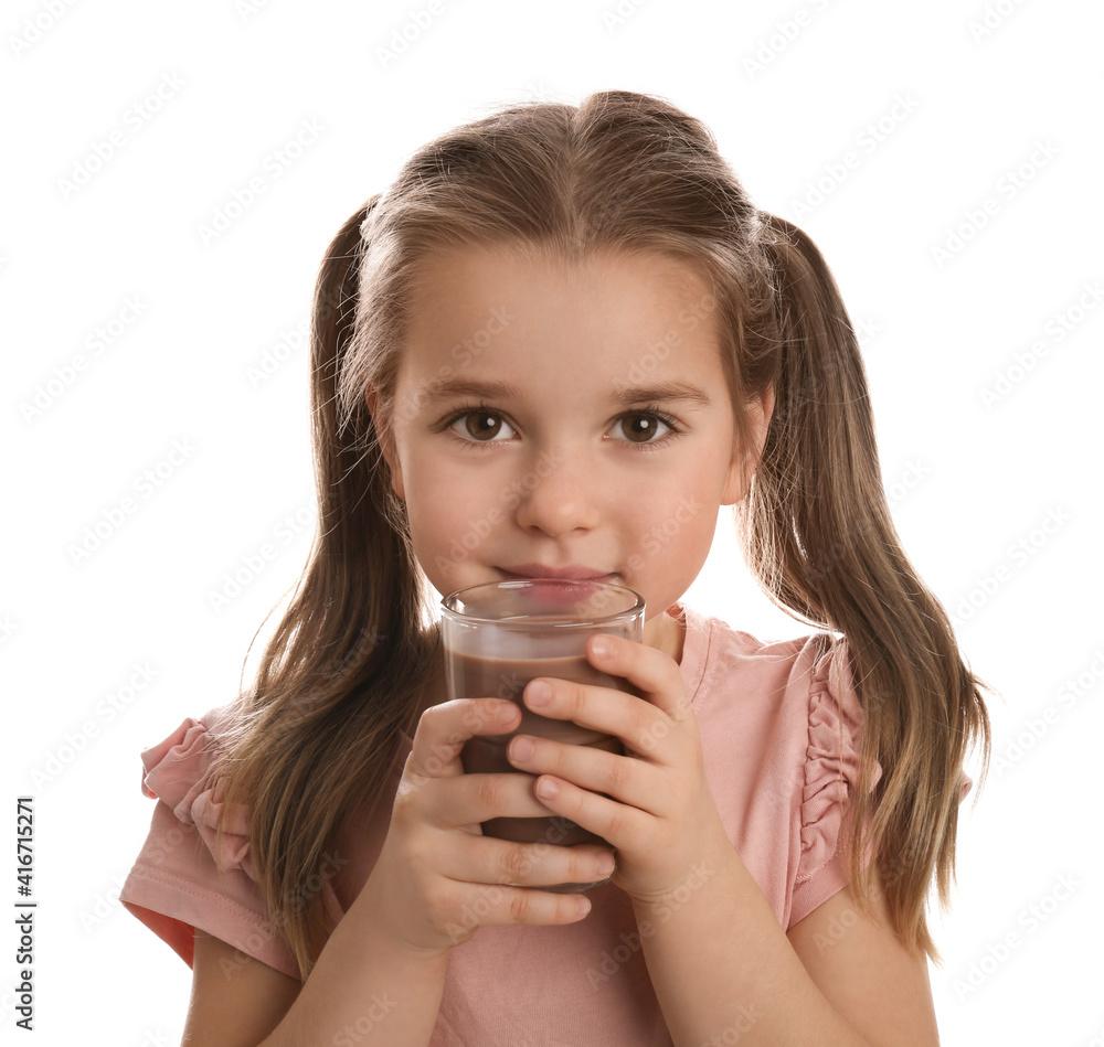 Fototapeta Cute little girl drinking chocolate milk on white background