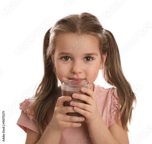 Cute little girl drinking chocolate milk on white background © New Africa