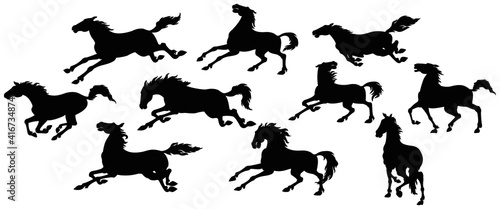 Fototapeta Silhouette of running horses in different poses and movements.  obraz