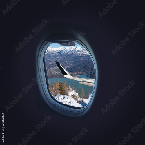 airplane porthole - view of a mountain landscape from the window of an airplane
