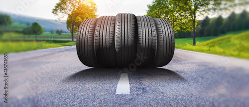 Obraz summer car tires on the street outside - fototapety do salonu