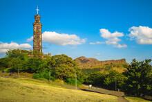 Nelson Monument At Calton Hill And Arthur Seat In Edinburgh, Scotland, Uk