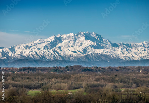 The snow-capped Monte Rosa chain on a sunny morning in winter..View of the Lombard Alps. #416751683