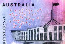 Close Up Of An Australia Five Dollar Note Showing A Line Drawing Of Parliament House Canberra, The Text Australia And The Number On The Bank Note