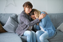 Elderly Mother Hug Crying Adult Daughter Show Support And Care , Supportive Senior Woman Embrace Cuddle Grownup Child Feeling Depressed, Having Life Problems