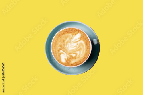 Fotografie, Obraz Flat lay latte art coffee in a cup isolated on yellow background.